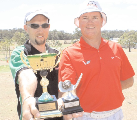 Blind golfer Glenn Niciejewski and caddy Scott Downing,with the latest trophies to add to their shelf following the Blind Golf Australian Open Championships.